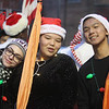 Lowell City of Lights parade. Lowell High marching band members from left, Natalie Ferreira, Terry Nguyen, and Lyeeighla Weatherspoon. (SUN/Julia Malakie)
