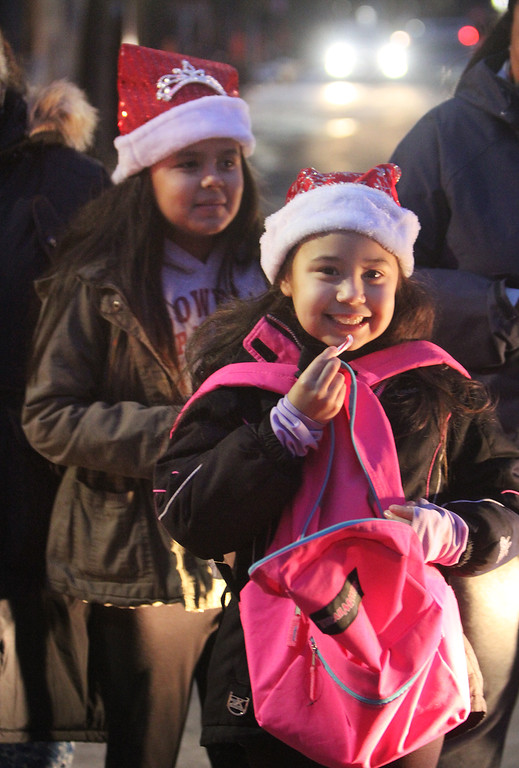 . Lowell City of Lights parade. Yalany Gillot, 11, rear, and her sister Yaniela Gillot, 8, of Lowell. (SUN/Julia Malakie)