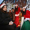 Lowell City of Lights parade. Lowell High senior Cody From left, Samantha Sousa, Victoria Nogueira, Barnard Krunch, Melyssa Gomes, Emily Sousa and Sopheakmonyratana Ouk, on Lowell High theater group's A Christmas Carol float, promoting upcoming performance. (SUN/Julia Malakie)