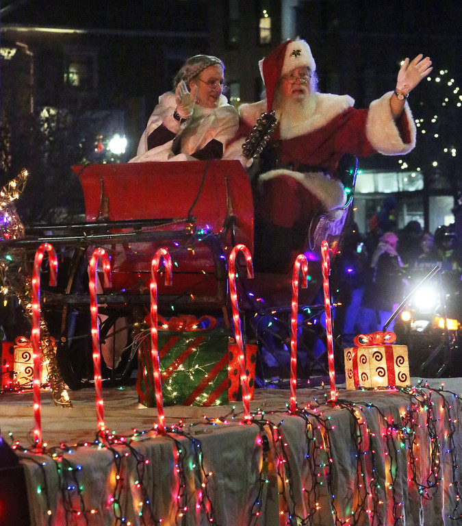 . Lowell City of Lights parade. Santa and Mrs. Claus arrive at City Hall. (SUN/Julia Malakie)