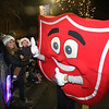 Salvation Army shield in Lowell City of Lights parade. (SUN/Julia Malakie)