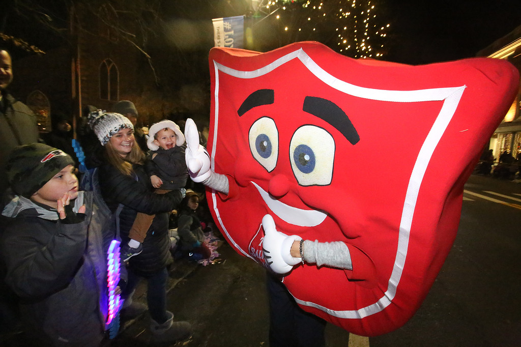 . Salvation Army shield in Lowell City of Lights parade. (SUN/Julia Malakie)