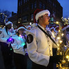 Lowell High senior Austin Silva on saxophone with marching band in Lowell City of Lights parade. (SUN/Julia Malakie)