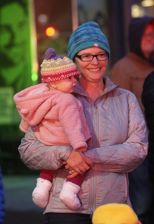 . Lowell City of Lights parade. Sarah Thompson of Lowell with daughter LYdia Thompson, 6 months old. (SUN/Julia Malakie)