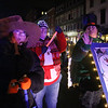 Lowell City of Lights parade. From left, Nettie Casey, 11, of Beverly, Sophie Blake and her mom Sukey Blake of Lowell. (SUN/Julia Malakie)
