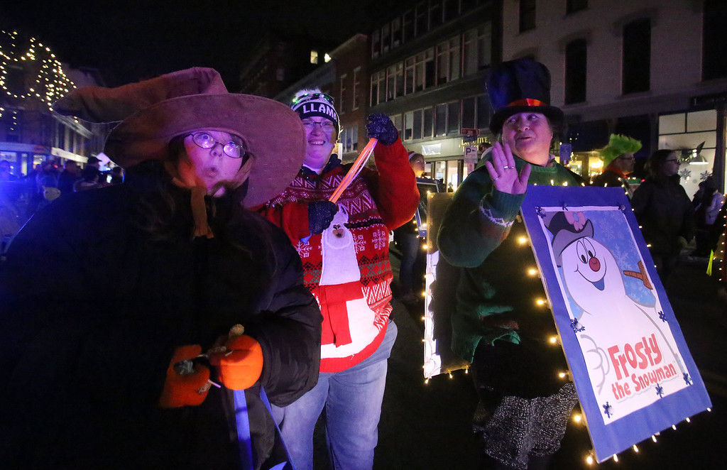 . Lowell City of Lights parade. From left, Nettie Casey, 11, of Beverly, Sophie Blake and her mom Sukey Blake of Lowell. (SUN/Julia Malakie)