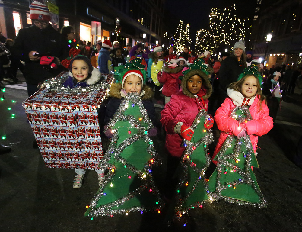. Lowell City of Lights parade. Girl Scout Daisy Troop members, from left, Aaliyah Boisvert, Karli Ippolito, Vera Mondelas, and Sophia Moreno, all of Lowell. (SUN/Julia Malakie)