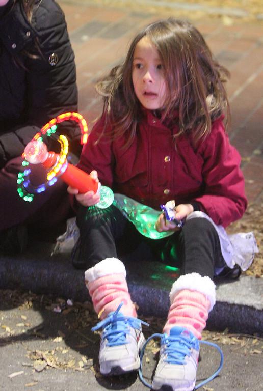 . Lowell City of Lights parade. Lela Nguyen, 6, of Lowell. (SUN/Julia Malakie)