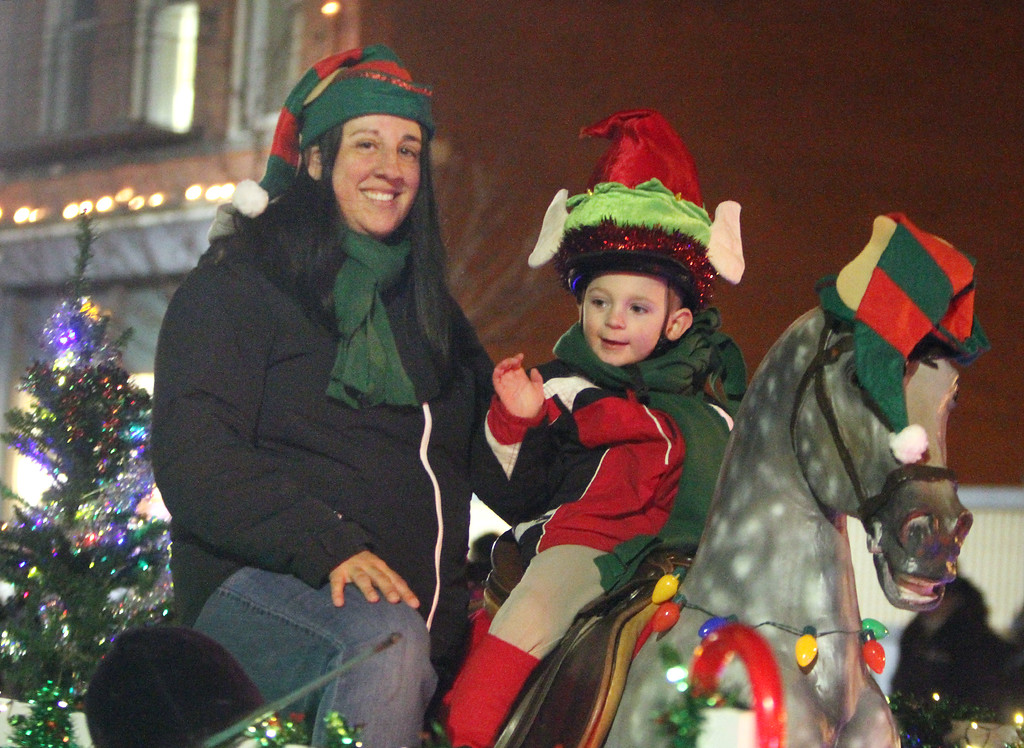 . Lowell City of Lights parade. Susan Papik and son Matthew Hoisington, 3-1/2, of Lowell, on the Littleton Hack \'n\' Tack float. (SUN/Julia Malakie)