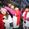 Lowell City of Lights parade. From left, Sienna Lefevbre, Morgan Yost, and Chloe McGrath, all 7 and from Lowell, with Girls Scout Troop 62409, in staging area on Jackson Street. (SUN/Julia Malakie)
