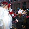 Lowell City of Lights parade. Santa and Mrs. Clause meet Gianna Ippolito, 8, of Lowell, with Girl Scout Troop 62712. (SUN/Julia Malakie)