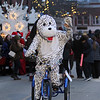 Lowell City of Lights parade. Peter Lovett, pastor of Christ Church United, wears a dalmation costume for a friend to represent PUPS pet store of Lowell. (SUN/Julia Malakie)