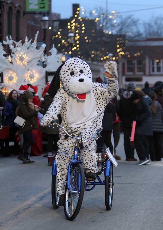 . Lowell City of Lights parade. Peter Lovett, pastor of Christ Church United, wears a dalmation costume for a friend to represent PUPS pet store of Lowell. (SUN/Julia Malakie)