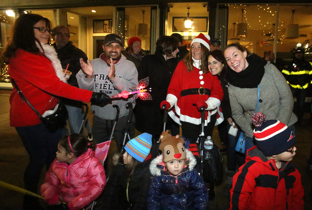 . Lowell City of Lights parade. From left rear, Marybeth Bonheur, Eleazer Cruz, Kelley Underwood and her daughter-in-law Melinda Underwood, all of Lowell, and Jamie Roman of Pelham, N.H. Kids, from left: Maya Underwood, 3, Olivia Rourke, 3, Breton Tanguay, 3, and Colton Tanguay, 4. (SUN/Julia Malakie)