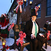 Lowell City of Lights parade. Lowell High senior Cody Martin, 16, as Scrooge on Lowell High theater group's A Christmas Carol float, promoting upcoming performance. (SUN/Julia Malakie)