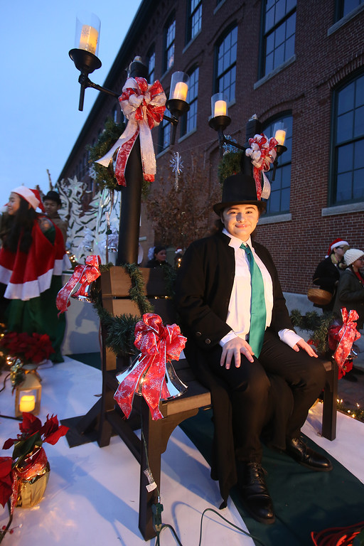 . Lowell City of Lights parade. Lowell High senior Cody Martin, 16, as Scrooge on Lowell High theater group\'s A Christmas Carol float, promoting upcoming performance. (SUN/Julia Malakie)