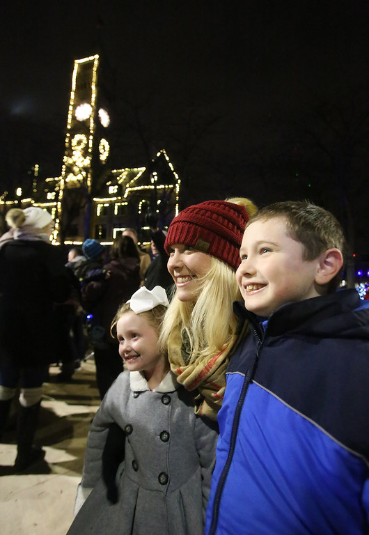 . Lowell City of Lights parade. Maggie Kennedy of Lowell with daughter Maeve White, 5, and son Michael White, 9. (SUN/Julia Malakie)