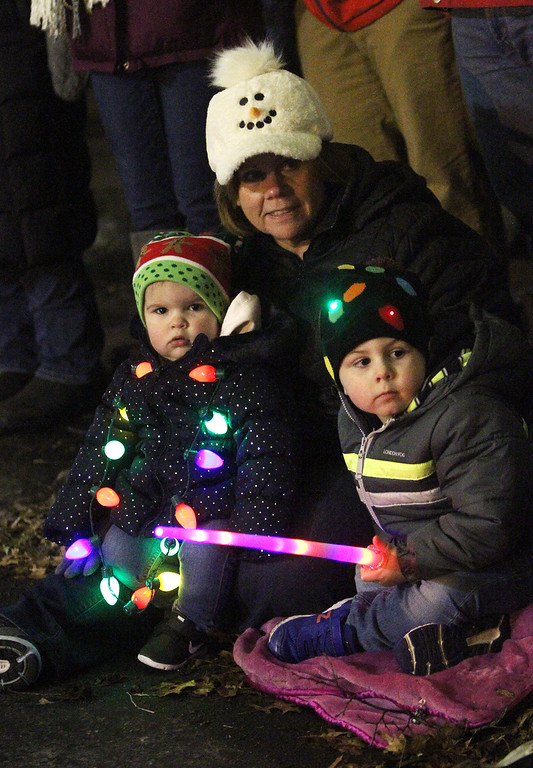 . Lowell City of Lights parade. Peggy Barter of Lowell with grandchildren Kaila Barter, 1, and Tyler Barter, 3, of Pepperell. (SUN/Julia Malakie)