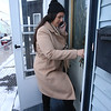 Samantha Jones calls her husband Mike Jones while she was having trouble getting the front door key to work at the house in South Lowell they just purchased with help from Merrimack Valley Housing Partnership's program for first-time home buyers. (SUN/Julia Malakie)