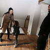 Samantha and Mike Jones and son Quentin, 5, in the new master bedroom the couple are creating from two smaller rooms. They purchased the house in South Lowell with help from Merrimack Valley Housing Partnership's program for first-time home buyers. (SUN/Julia Malakie)