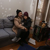 Samantha Jones and son Quentin, 5, in the living room of their house in South Lowell they just purchased with help from Merrimack Valley Housing Partnership's program for first-time home buyers. (SUN/Julia Malakie)