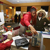 Flora Arraheffege, 16, and her grandmother Bridget Mbeng, both of Lowell, holiday shopping at Pollard Memorial Library. (SUN/Julia Malakie)