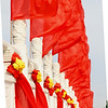 The ever auspicious red... flag in the wind don upon a stone bridge