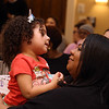 Living the Dream Partners hold 2020 Martin Luther King Jr. Celebration. Award recipient Leslie Rivera of Lowell, reengagement specialist with UTEC, with granddaughter Camila Nieves, 3, of Lowell. (SUN/Julia Malakie)