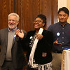 """Living the Dream Partners hold 2020 Martin Luther King Jr. Celebration. From left, Phil Sisson, Maria McDuffie, and Ked Kaeokit, all of Lowell, clap along to """"Oh Happy Day."""" (SUN/Julia Malakie)"""