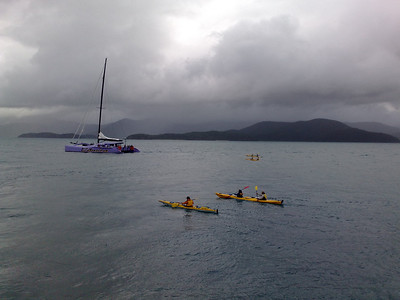 20090621_0856_513 Sea kayakers and catamaran just off Daydream Island. Not such sunny weather...