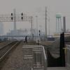 An idiot running across the tracks