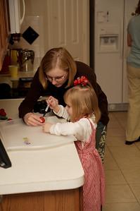 "Mary's friend, Emma, putting ""seeds"" on a walnut to make it look like a strawberry."