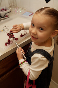 Mary's friend, Eleanor, putting kisses inside a wisk for a chocolaty recipe later.