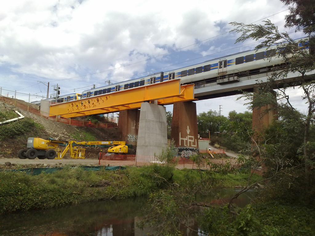20081127_224 The railway bridge over Merri Creek, between Westgarth and Clifton Hill. At the moment, there is only a single track between these two stations. But it looks like they found some spare material from the recent Eastlink tollway project and are at last 'doubling' the track! At the moment, the Merri Creek bicycle path at this point is closed, but should re-open again shortly...