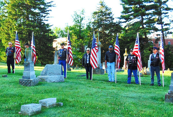 Debbie Blank | The Herald-Tribune<br /> Indiana Patriot Guard Riders carried flags to six cemeteries and decorated Liberty Park with them.