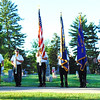 "Diane Raver | The Herald-Tribune<br /> ""Taps"" is played at Holy Family Catholic Cemetery by a Batesville Veterans of Foreign Wars Post 3183 color guard member."