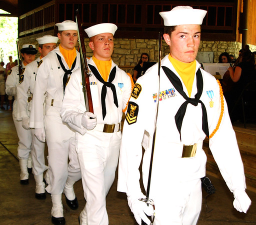 Debbie Blank | The Herald-Tribune<br /> U.S. Naval Sea Cadet Corps Flying Tigers Squadron members marched flags to the pavilion's front and brought military pomp to the holiday event.