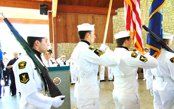 The Flying Tigers present the colors in the Liberty Park Pavilion during Memorial Day May 29.