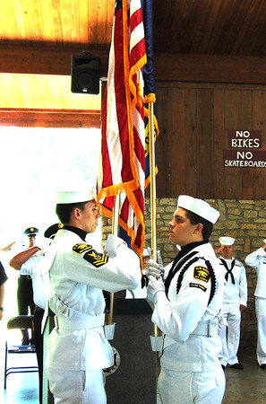 Debbie Blank | The Herald-Tribune<br /> U.S. Naval Sea Cadets Flying Tigers get ready to retire the flags.