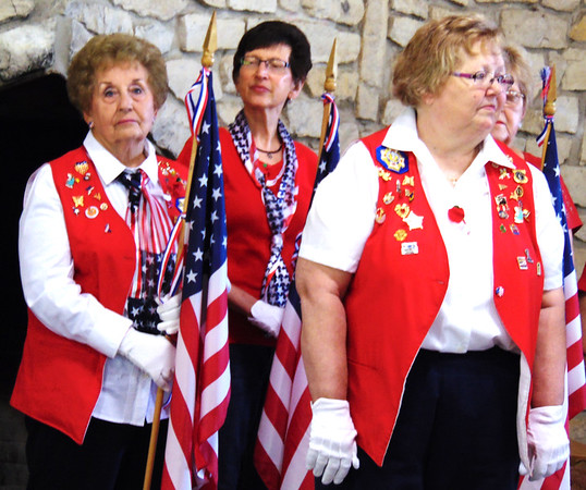 Debbie Blank | The Herald-Tribune<br /> VFW Auxiliary members brought patriotic colors into the pavilion.