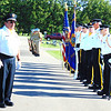 Debbie Blank | The Herald-Tribune<br /> VFW Commander Tom Fritsch (from left) addresses attendees at the St. John's United Church of Christ, Huntersville, Cemetery ceremony while American Legion Post 271 and Batesville Veterans of Foreign Wars Post 3183 members get ready to participate.