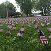American flags -- one representing each of the 6,868 U.S. servicemen and women who have died protecting us since 9/11 -- blanket the field off the rotary in Pepperell.