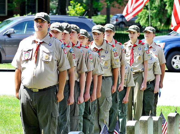 John P. Cleary | The Herald Bulletin<br /> Boy Scout Troop 301 members lineup for the beginning of the Memorial Day Remembrance Ceremony they hosted at Maplewood Cemetery Monday.