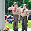 John P. Cleary | The Herald Bulletin<br /> Boy Scout Troop 301 members salute after placing a wreath in front of the veterans memorial at Maplewood Cemetery during the Memorial Day Remembrance Ceremony they hosted.