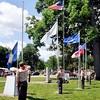 John P. Cleary | The Herald Bulletin<br /> Boy Scout Troop 301 members man the flagpoles as they raise the colors of each of the six branches of the service during the Memorial Day Remembrance Ceremony at Maplewood Cemetery Monday.