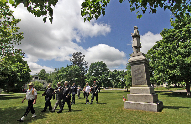The Honor Guard leaves the Shirley Center Green during Memorial Day ceremonies in Shirley. SUN/ David H. Brow