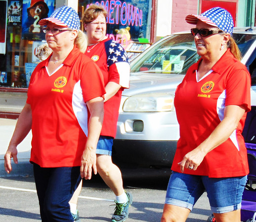 Debbie Blank | The Herald-Tribune<br /> Two Brookville American Legion Auxiliary members knew patriotic caps would help beat the scorching sun's rays.