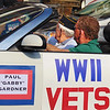 "Debbie Blank | The Herald-Tribune<br /> World War II veteran Paul ""Gabby"" Gardner surveys spectators. Other veterans of that war who rode in separate cars were Phil Blose, Charlie Sprague, Bob Pennington and Bernard Moster."