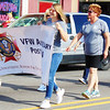 Debbie Blank | The Herald-Tribune<br /> Brookville VFW Auxiliary members carry a patriotic banner.