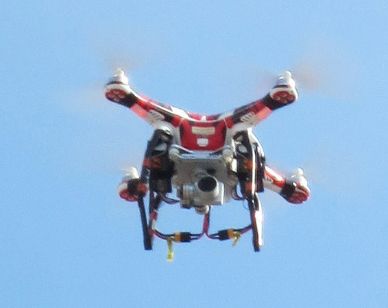 Debbie Blank | The Herald-Tribune<br /> One man was using a drone to capture the Main Street action.